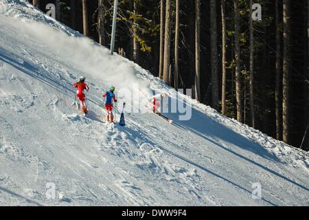 Downhill skiers on piste of Todorka mountain, Bansko, Bulgaia - Stock Photo