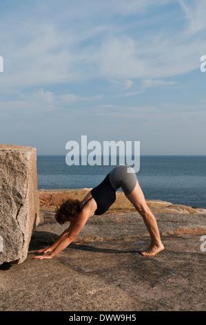 Iyengar Yoga Instructor Demonstrates Adho Mukha Svanasana (Inverted). - Stock Photo