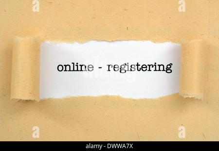 Online - regisrering text on paper hole - Stock Photo