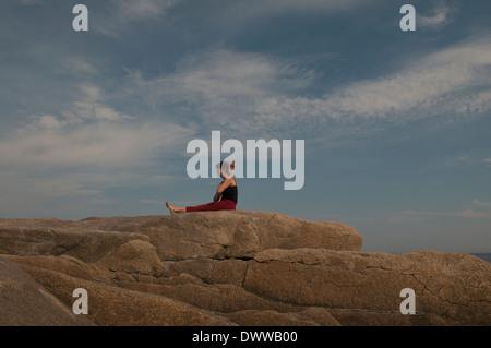 iyengar yoga instructor demonstrates eka pada raja