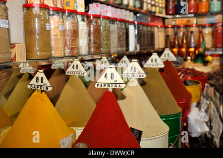 Spices and herbs for sale in market stall of souk, Marrakech, Morocco - Stock Photo
