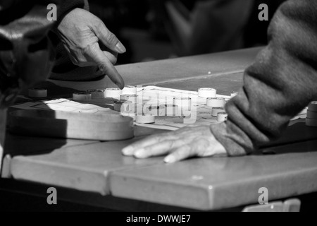 Game of Chinese Chess in Columbus Park, China Town, New York, USA - Stock Photo