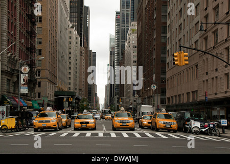 Athens Green Cab >> YELLOW TAXI CAB WAITING AT PEDESTRIAN CROSSING WITH VIEW TO EMPIRE Stock Photo: 3193061 - Alamy