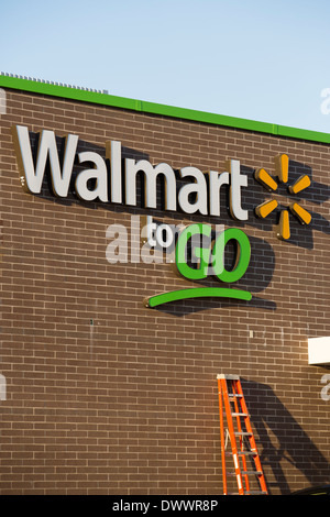 The sign on the outside of the new Walmart To Go concept convenience store under construction in Bentonville, AR, - Stock Photo