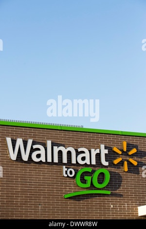The sign on the outside of the new Walmart To Go concept convenience store in Bentonville, AR, USA. - Stock Photo