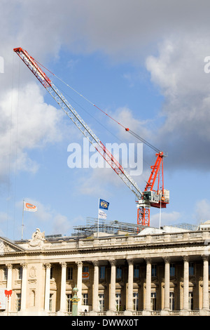 Red and White construction crane behind the Louve Paris - Stock Photo