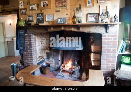 The Frog Pub and Restaurant Fireplace in Skirmett in Buckinghamshire - UK - Stock Photo