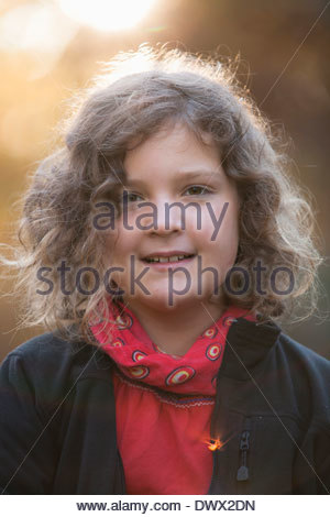 Portrait of girl smiling outdoors - Stock Photo