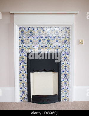 Delftware tiles round a fireplace in an English manor house, in the art and crafts style, c1903 - Stock Photo