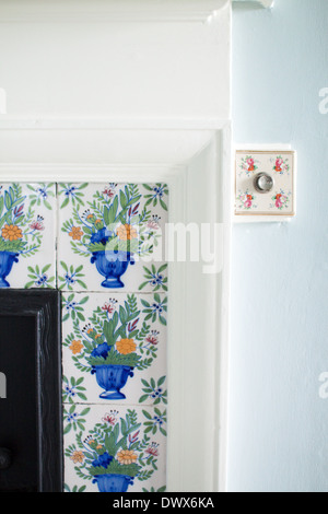 Delftware tiles & servant bell push in an English manor house, in Cornwall, in the art and crafts style, c1903 - Stock Photo