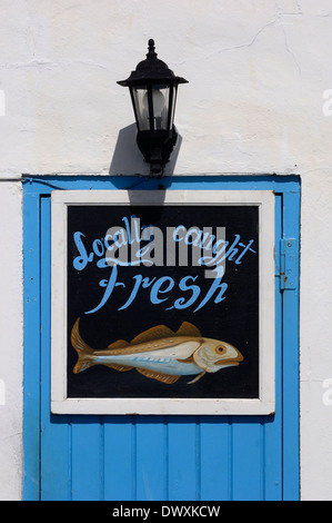 Hand painted sea fish shop sign. Hastings. East Sussex. UK - Stock Photo