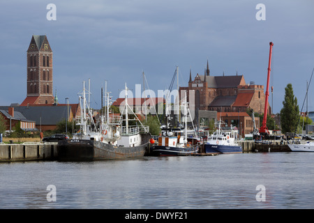 Wismar, Germany, Age fishing harbor with church St. Mary's and St. George's Church - Stock Photo
