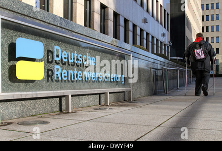 Berlin, Germany, a woman on crutches on the way to the German Pension Berlin -Brandenburg - Stock Photo