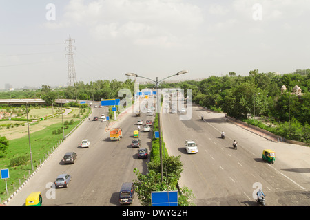 Indian Traffic on Road, Traffic on Highway, Elevated view of traffic, Traffic. Road side, Car, Auto, Bike, Transportations, - Stock Photo