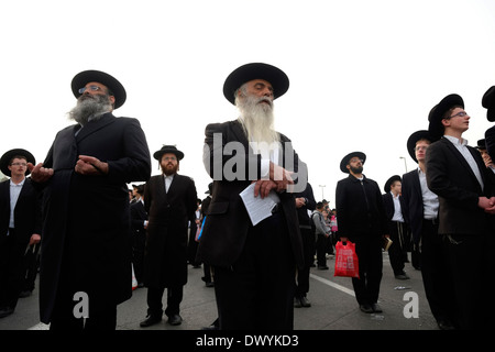 A mass protest of ultra-Orthodox Jews enraged over plans to conscript their young men for military service in Jerusalem - Stock Photo