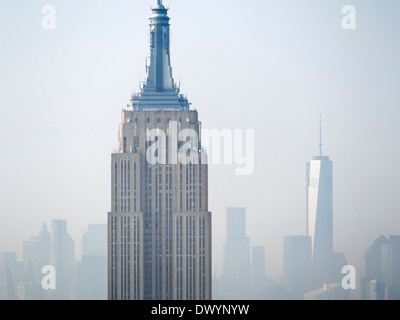 The Empire State Building and new One World Trade Centre viewed from the Rockefeller Building on a misty day in - Stock Photo