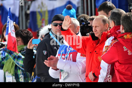 Sochi, Russia. 15th Mar, 2014. Russian President Vladimir Putin visits the 4 x 2.5km Relay at the Cross-Country - Stock Photo