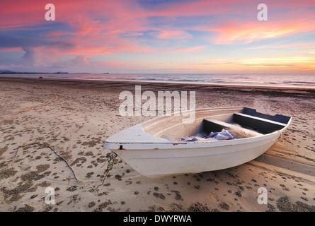 Boat and beach sunset in Tanjung Aru beach, kota kinabalu, sabah, borneo, malaysia - Stock Photo