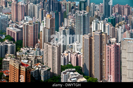 Looking down into concentrated urban accommodation in a high-rise jungle on Hong Kong Island - Stock Photo