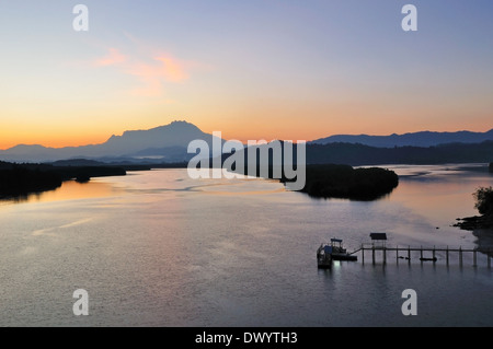 Tranquil sunrise scene at Kota Kinabalu Sabah Malaysia - Stock Photo
