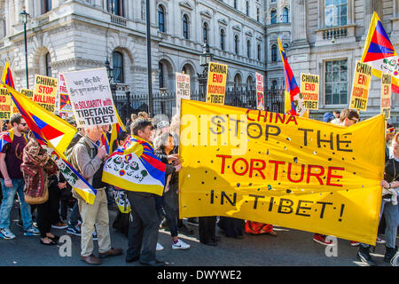 Organisations calling for a free Tibet hand in a petition to Number 10 Downing Street and then march on the Chinese - Stock Photo