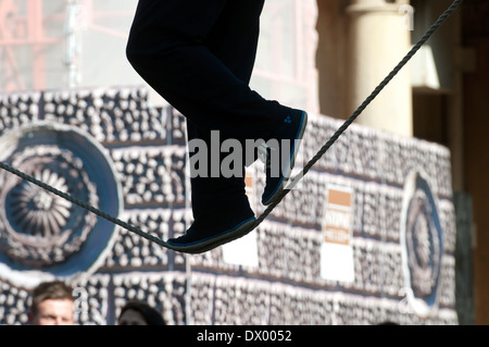 Busker on a tightrope, Bath, Somerset, England, UK - Stock Photo