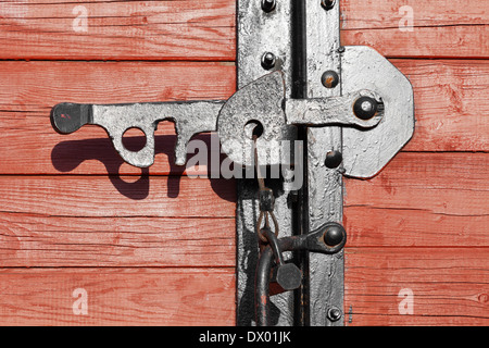 Closeup of a vintage wooden latch on a building - Stock Photo