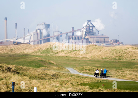 Redcar Blast Furnace of Thai company SSI steel works with Cleveland Golf Course in the foreground - Stock Photo