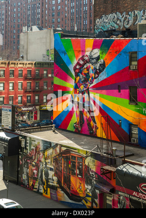 Graffiti art installation on buildings seen from the High Line, New York's elevated park created on a disused railway - Stock Photo