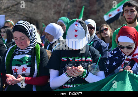 Washington DC, USA . 15th Mar, 2014. Syrian American women pray in front of the White House Saturday during a rally - Stock Photo