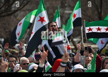 Washington DC, USA . 15th Mar, 2014. Activists waive the Syrian and American flags during a rally in front of the - Stock Photo