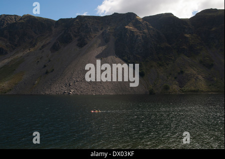 Two people canoing on Wastwater on a sunny day in the Lake District. the background is made of the famous screes - Stock Photo