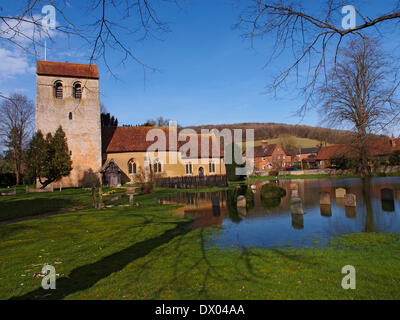 First signs of Spring but the St Bartholomew church in Fingest, Buckinghamshire is still surrounded by flood water - Stock Photo