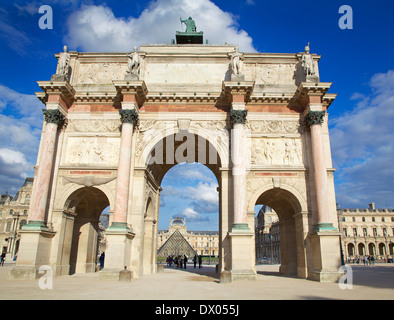 Arc de Triomphe du Carrousel and Louvre Museum on the background - Stock Photo