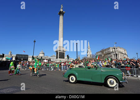 London, UK. 16th March 2014. Participants in the St. Patrick's Day Parade 2014 in London, England passing Nelson's - Stock Photo