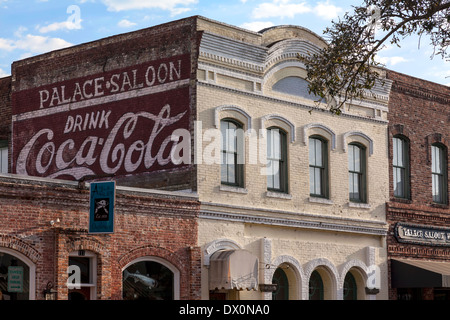 Hand-painted Coca Cola sign on exterior brick wall of old building in historic downtown district of Fernandina Beach, - Stock Photo