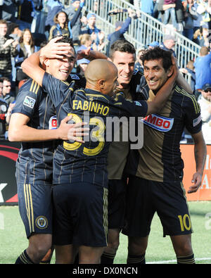 Philadelphia Union forward Sebastian LeToux celebrates his game winning goal with a host of international players - Stock Photo