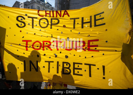 Annual Tibet protest march for Freedom from Chinese occupation in London - Stock Photo