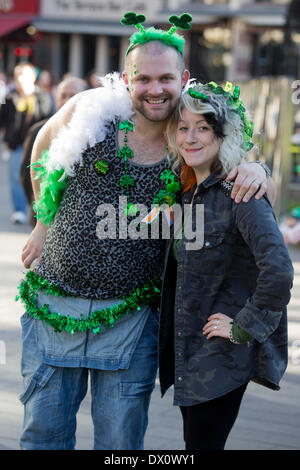 London, UK. 16th Mar, 2014. Couple in Leicester Square. St. Patrick's Day Celebrations in Central London, United - Stock Photo