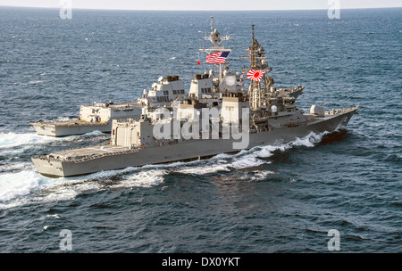 Japan Maritime Self-Defense Force destroyer Takanami sails alongside the US Navy Arleigh Burke-class guided missile - Stock Photo