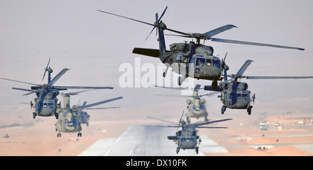 Six US Army UH-60L Black Hawks and two CH-47F Chinooks helicopters, assigned to Task Force Brawler simultaneously - Stock Photo