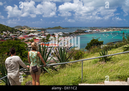 Tourists on steps leading up to Fort Louis stop to admire view of Marigot in St. Martin - Stock Photo