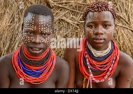 Karo girls with face paint in Kolcho on the Omo River, Ethiopia - Stock Photo