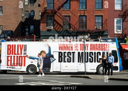 A tour bus with advertising musical Billy Elliot goes ahead of Greenwich Village. At present, although endures bohemian - Stock Photo