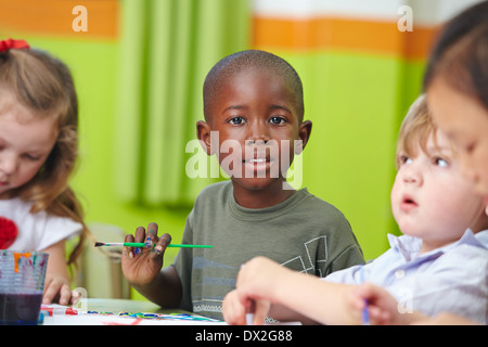 Interracial Children Drawing Together Stock Photo