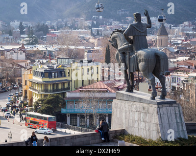 The old town of Tbilisi, the capital of Georgia, seen from the Metekhi church with the statue of King Vakhtang Gorgasali. - Stock Photo