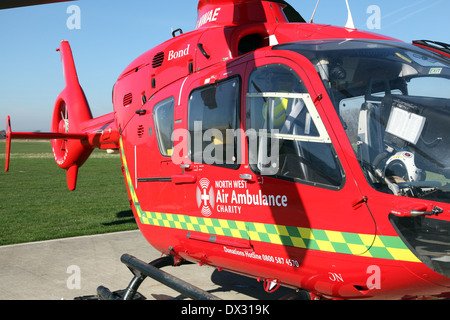 one of the three North West Air Ambulances, a red Eurocopter EC135 helicopter aircraft operated by Bond Air Services - Stock Photo