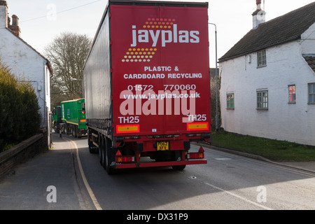 HGV lorry passing by houses on a road in the village of Rempstone, Nottinghamshire, England, UK - Stock Photo