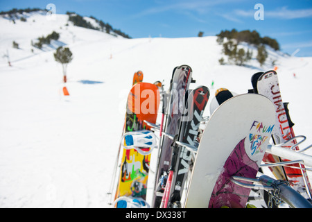 Skis and snowboards on a rack in Andorra - Stock Photo