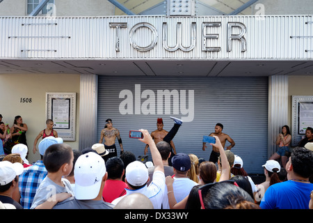 MIAMI - MARCH 9, 2014: People watching live street performers during the 37th Calle Ocho festival, an annual event - Stock Photo